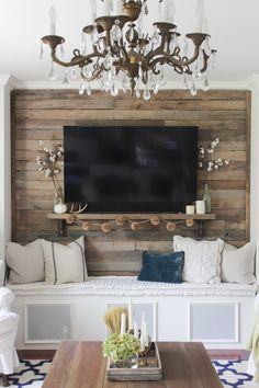 Pallet accent wall with simple fall touches, and a brass chandelier