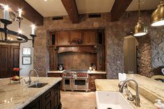 Luxury Kitchen with rustic touch of heavy beams and stone walls Oh yes please!!