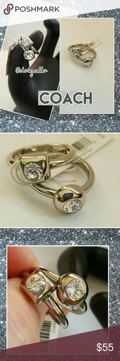 COACH ring set nwt Silvertone double ring set Clear round CZ stones framed by a round setting on one ring and a square setting on the other Very pretty and sparkly! Size 6 Coach Jewelry Rings