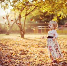 Adorable toddler embracing autumn in awe. #autumn #photography #child