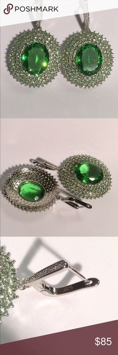 Silver.925 Green Tsavorite Garnet And CZ Earrings Silver.925 Stamped Big Stone Green Tsavorite Garnet And White CZ Earrings. 60x37mm! The Central Stone is 22x18 mm and hundreds of little 3 mm sparkling Stones around, makes absolutely amazing design and gorgeous look.  Of course you will not wear them to work BUT!!! Any Special Occasion- VERY WELCOME! You will look absolutely beautiful! Be a Queen!  Thousand compliments yours! *** Tsavorite Garnet is Lab Created Stone. Thank you for choosing…