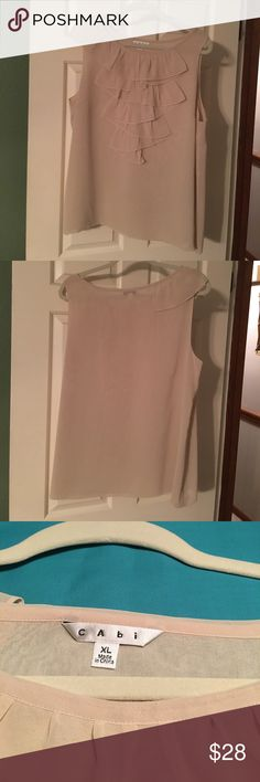 👚CAbi Top Style 643. Blush beige cascading ruffle CAbi sleeveless Top Style 643. Blush beige cascading ruffle. 2 layers of sheer. 100% polyester. Barely worn and in perfect condition. CAbi Tops Blouses