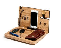 This personalized Docking Station is made for your order from Oak solid wood. We use only natural materials and water based eco friendly finish coating. Master carefully selects Each piece of wood so you can enjoy its beautiful texture. Each item is unique, as the unique texture of natural wood. Personal laser monogram will emphasize the value of your gift.  This is the perfect gift for a husband or boyfriend, a gift for the boss or employee for any occasion.  Stand has an opening for cable…