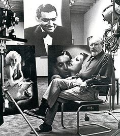 George Hurrell in his studio with some of his famous photographic portraits