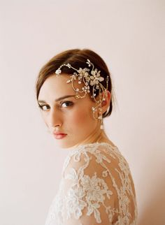 Rhinestones and pearl add sparkle and shine to a striking headpiece.