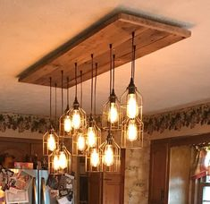 Handmade Industrial Cage Pendant Barn Wood Chandelier 4 to 12 Cage Pendant Chandelier 5 Varients. to the United States Handmade Chandelier, Rustic Chandelier, Pendant Chandelier, Farmhouse Chandelier, Chandelier Lighting, Reclaimed Barn Wood, Rustic Barn, Rustic Wood, Room Lights