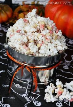 Monster Munch {Halloween Popcorn Mix}  1 package Almond Bark (1 lb)12 C popped popcorn (about 1/2 C kernals)1 C candy corn1 C dry roasted, salted peanuts1/2 C Reeces Pieces