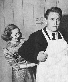 Beth Davis 'aproning' Spencer Tracy.