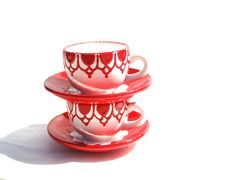 Small teacups with red shabby chic style.
