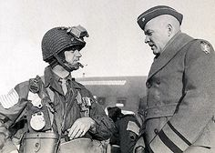 Brig Gen Floyd Parks (right), Chief of Staff for the 1st Allied Airborne Army, talks with     Maj Gen William Miley, CO 17th Airborne Division, before take-off for Operation Varsity.