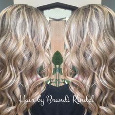 WOW!!!! Taylor's blonde hair is stunning!  Just trimmed and styles today, retouch of her highlights coming soon!  Beautiful beach waves are my favorite!!!!!