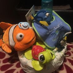 Unisex finding Nemo diaper cake Large stuff Nemo Fisher price Nemo character turtle toy 2 plastic Nemo character a toys  Bib Nemo crib sheet Bottle  Teether Pacifer Diapers All wrap in plastic with ribbon Other