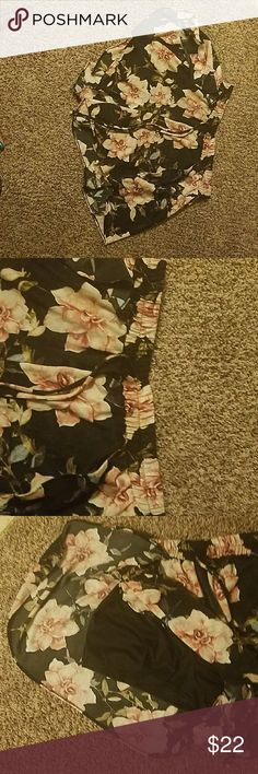 Forever 21 floral shorts Pink, black, green & some accents of blue. high low design (low in back) black shorts underneath. drawstring design. silk material.  ruffle style shorts. worn 1x Forever 21 Shorts