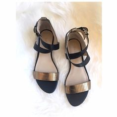 Enzo Angiolini Black & Gold Sandals Black and gold Enzo's with adjustable ankle straps and jute weaved detail. Lovely pair, only wore a 2-3 times. Minor brushing, scratching on top - not too noticeable. Sz 8 M. Comes with original box. **No trades** Enzo Angiolini Shoes Sandals