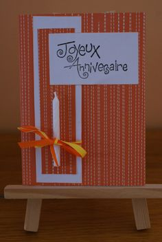 Carte anniversaire avec bougie, coloris orange et blanc