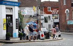 People at an outdoor corner cafe in Rye, Sussex, England.