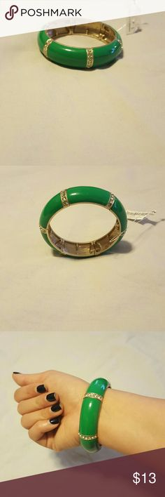 Green Bangle Beautiful green bangle with light green rhinestones going down the sides, this is definately the pop of color you need this summer, stretchy, never worn absolutely gorg Accessories