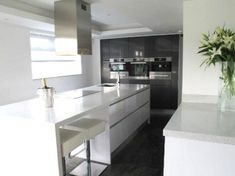 White tops on white units, with stainless steel accessories that set off the grey. Makes me think black tops on white units with grey floor to ceilings isn't the way to go.