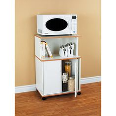 Microwave cart- need something like this for the space between my stove and fridge in the new apartment! I don't want to sacrifice my tiny amount of counter space for the microwave/toaster/blender, even if there were outlets on that side of the room!