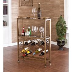 This wine storage bar offers an open storage rack for up to 25 bottles of wine. Add this wine bar to your dining room, kitchen, or family room. The antique finish and scrolling pattern work well in transitional to contemporary homes.