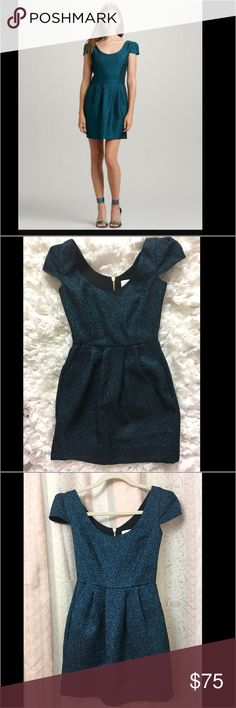 Amanda Uprichard Cusp by Neiman Marcus Dress Amanda Uprichard Cusp by Neiman Marcus Dress.  Adorable dress for a petite young lady.  Size P. Teal shimmery  color.  Cap sleeves Amanda Uprichard Dresses Mini
