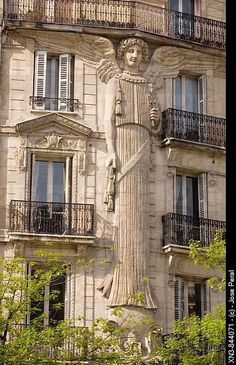 Building detail: the Angel of the apartment building in 57 Rue de Turbigo, Paris, France. Designed by architect Eugène Demangeat in 1860.  Learn more about French travel and culture at www.talkinfrench.com