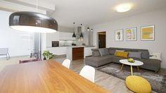 Obývací pokoj s kuchyní a jídelnou je velkorysý prostor s výklenkem a vstupem na terasu v prosklené stěně.