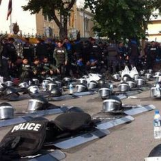 Police in Thailand Lay Down Weapons and Join with Protestors