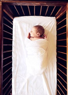 Sweet photo of newborn in crib - perfect for a baby announcement