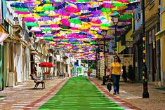 Imagine yourself walking down the streets of Portugal, coffee in one hand, and shopping bag in the other. As you make your way down the blazing hot street, you silently wish for shade. Then, suddenly out of nowhere, your wish is granted. Above your head floats an array of brightly colored umbrellas, each one a …