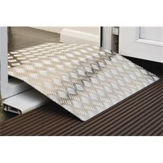 "A one piece lightweight doorframe ramp providing wheelchair users with a convenient solution for door thresholds. Clearance level of up to 70mm (23⁄4""). Light to carry and can be easily stored when not in use. Made from aluminium with a durable slip resistant track for grip and safety.    Length: 900mm (35"").  Width 690mm (27"").  Floor clearance: 70mm (2¾"").  Product weight: 5.5kg.  Maximum user weight: 130kg (20½st). Repin from Tiffany."
