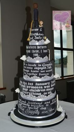 This cake depicts the couple pulling their lives together in marriage. The black side has their own love story written in caulkboard style and the white side is silhouette pictures of their story. This was a challenging but fun cake to make