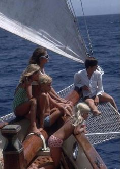 Dolores Guinness with her children on a boat in Sardinia.
