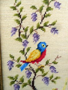Here for your consideration is a sweet little needlepoint bird picture. I think that the needlepoint is older and maybe from the 40s or before. I think that it was framed later...probably in the 70s. The picture is handmade and shows inconsistent stitches and not perfect. It is in excellent condition. It measures 17x9