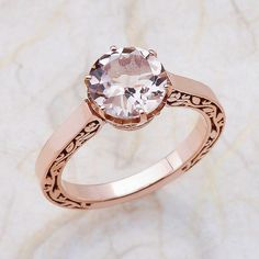 Ladies 14K rose gold engagement ring. The center is a 8x8 round cut Morganite. For any reason you have any kind of question please contact us we