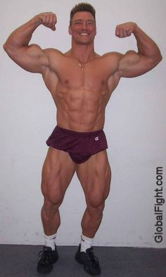 a monster bodybuilder large man trapezius traps triceps muscles