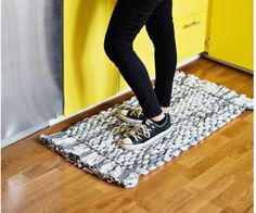 DIY Woven Rug Tutorial | Turn old sheets into a chic new rug with this easy no sew project!