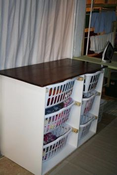 clever laundry table - maybe label each basket for each person
