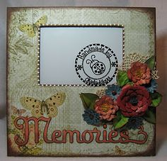 Supplies Used:  Ready to Finish 12x12 Memory Frame  Pink Paislee Butterfly Garden Collection  Various Cardstock  Cricut Flower Shoppe cartridge  Cricut Home Decor cartridge  Imaginesce Heat Set Pearls  Small Doilies  Glimmer Mist  Cat Eye Chalk Ink  Glittered Brads