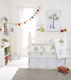 nursery with clean white walls and little pops of color