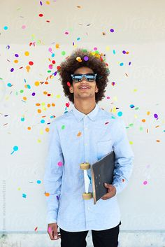 Stock photo of Portrait of a young afro man with confetti. by BONNINSTUDIO Professional Portrait, Young Professional, Justin Photos, Afro Men, Model Release, Confetti, The Unit, Stock Photos, Lifestyle