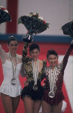 Kristi Yamaguchi (USA) (gold medal, in the centre), Midori Ito (JPN) (silver medal, right) and Nancy Kerrigan (USA) (bronze medal, left) after the medal ceremony for the women's individual figure skating event in Albertville in 1992  ©Getty Bernard Asset