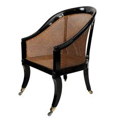 An English Early Century Regency Ebonised Library Chair with Sabre Legs and Brass Square Cup Castors. Canework in Good Condition, Circa Height: 81 CM Seat Height: 36 CM Width: 59 CM Depth: 54 CM Shop our full collection of Seating here at Vinterior Furniture Depot, Cane Furniture, Online Furniture, Modern Furniture, Rattan Dining Chairs, Outdoor Chairs, Library Chair, Wayfair Living Room Chairs, Beautiful Houses Interior