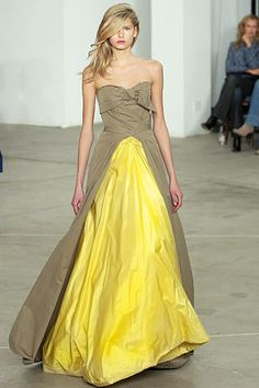the neutral dull with yellow popout effect, works because of proportions and cuts -- Roland Mouret