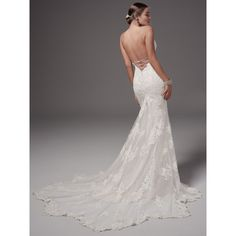 Chic and alluring, this fit-and-flare wedding dress features shimmering lace appliqués and bead detailing over tulle and Inessa jersey. Gorgeous crisscross strap details accent the gown's open back… MAggie Sottero Bristol back Wedding Dress Trends, Designer Wedding Dresses, Wedding Gowns, Tulle Wedding, Fitted Wedding Dresses, Backless Mermaid Wedding Dresses, Dress Formal, Wedding Venues, Wedding Rings