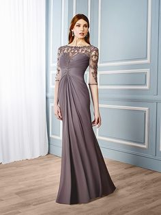 Val Stefani Style MB7544AN ELEGANT MOTHER OF THE BRIDE GOWN PERFECT FOR UPSCALE SKYRISE WEDDINGS. BEADED EMBROIDERY ACROSS THE ILLUSION NECKLINE ADDS TO THE LUXURIOUS CENTER WAIST DRAPING, WHILE THE BATEAU NECKLINE AND 3/4 SLEEVES GIVE THE GOWN A CLASSIC FINISH.
