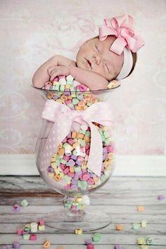 Very sweet newborn/valentine photo! I had better stock up on conversation hearts now!