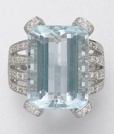 18K WHITE GOLD, AQUAMARINE AND DIAMOND RING.  1 aquamarine and 140 diamonds approx 16.25 & 1.20 cts