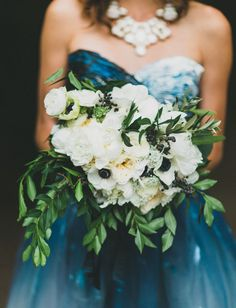 White + green anemone bouquet and a blue wedding dress
