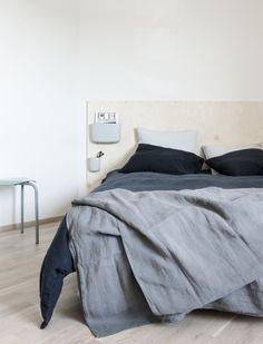 plywood headboard with Normann Copenhagen Pocket organizers. Interior design by Minna Jones, photography by Pauliina Salonen